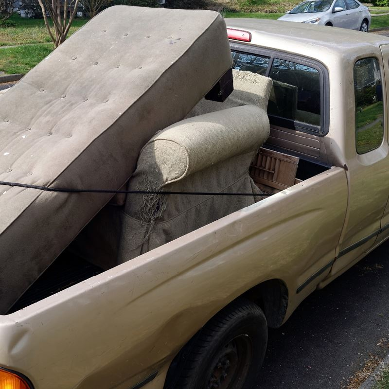 Truck with sofa in the truck bed.